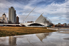 Milwaukee Art Museum Reflections (Seth Oliver Photographic Art) Tags: wisconsin architecture clouds reflections iso200 nikon skyscrapers cities cityscapes lakemichigan milwaukeeartmuseum milwaukee cropped pinoy lakefront circularpolarizer urbanscapes quadraccipavilion d90 wetreflections tonemapped handheldshot aperturef90 manualmodeexposure setholiver1 18105mmnikkorlens 1200secondexposure