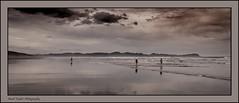 Kawhia beach (Jamie B Ernstein) Tags: sea newzealand sky people cloud reflection beach kids landscape sand nikon waves wandering kawhia aotea