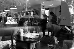 moa tomando caf (Milla Garofalo) Tags: city cidade people bw glass coffee girl vidro reading cafe shadows saopaulo pb line starbucks sp canondigital canont1i