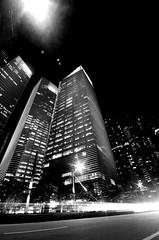 Singapore by Night (Portrait) (jonnyharvell) Tags: road longexposure nightphotography travel sunset lightpainting cars architecture buildings dark lights high nikon singapore glow skyscrapers traffic towers vertigo wideangle headlights latenight nighttime glowing tall lighttrails 1020mm architects carlights wealth centralbusinessdistrict traffictrails marinabay longshutterspeed businessdistrict joby sigma1020 gorillapod shutterspeedpriority marinabaysands d5100 singaporecitycentre nghtshooting
