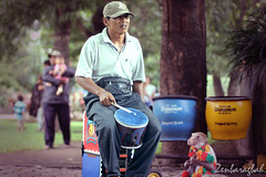 Monkey Business (baragbahzen) Tags: old city holiday man guy love animal work indonesia fun toy monkey peace play centre crowd visit dude business entertainment malang noise indo bloke