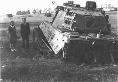 Tamed Beasts - Civilians looking at German heavy tank Pz.Kpfw. VIB Tiger II, stuck in damp meadows. Bohemian town of Trebon neighborhood. Czechoslovakia, in May 1945. (Krueger Waffen) Tags: vintage war tank tiger wwii 1940s armor ww2 wreck armour armored waffenss tanks panzer kingtiger secondworldwar afv worldwartwo armoredvehicle armoured armoredcar wehrmacht markvi tigertank pzkpfw tigerii royaltiger pzkpfwvi secondworldwartanks worldwartwotanks tanksofthesecondworldwar