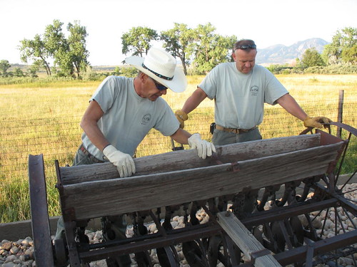 Photo - OSMP Staff examining a grain drill