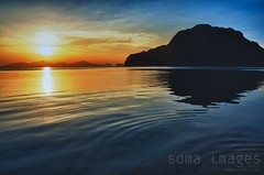 Ripples of color (Soma Images) Tags: ocean blue sunset sea sun jason man color reflection green water colors hat clouds boats mirror islands bay boat agua aqua paradise floor philippines azure el images cliffs chain virgin reflect anchor limestone oar mirrored filipino glowing remote soma shallow filipina transparent nido coron watercraft extraordinary archipelago banca elnido palawan otherworldly undisturbed seafloor jasongreen bacuit somaimages