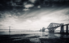 Two Bridges (Philipp Klinger Photography) Tags: road uk longexposure greatbritain bridge sea sky blackandwhite bw cloud white black reflection water rock architecture clouds reflections river landscape scotland blackwhite rocks edinburgh long exposure slow unitedkingdom britain steel tide great north bridges rail railway landmark forth filter northsea nd slowshutter shutter fjord lowtide brcke firth schottland firthofforth forthbridge queens