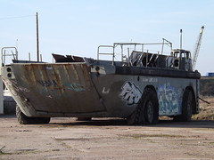 US Army LARC at its new location in Tipner Scrapyard (RobManBoy66) Tags: abandoned john army graffiti us flat crane craft cargo vehicles trail portsmouth disused scrapyard lighter derelict tyres amphibious pounds pilgrims exmilitary hilsea resupply m275 larcs tipner