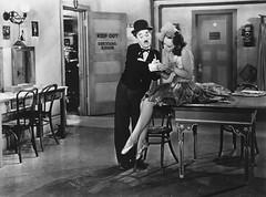 Paulette Goddard crit les paroles de la chanson sur les manches de Charlie Chaplin (Charlie Chaplin: du muet au parlant) Tags: film 1936 archive charlot paroles stills cinma chant charliechaplin bfi manches paulettegoddard photofilm tempsmodernes filmmuet