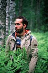 In the wood (Iurii & Natali) Tags: portrait classic analogue vintage nikon f80 velvia chrome fuji color slide wood forest man napapijri russia karelia summer green