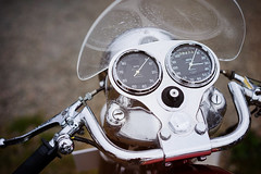 Royal Enfield in detail (Eric Flexyourhead) Tags: surrey britishcolumbia bc canada southsurrey crescentbeach crescentbeachconcoursdelegance 2016 detail fragment british motorcycle motorbike bike vintage classic old enfield royalenfield instruments gauges tachometer revcounter speedometer smiths metal chrome polished shiny fairing windscreen handlebars raindrops shallowdepthoffield bokeh sonyalphaa7 zeisssonnartfe55mmf18za zeiss 55mmf18