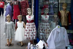 Well-dressed children - DSCF6908a (normko) Tags: london street shop clothes southall children dummy mannequin window reflection