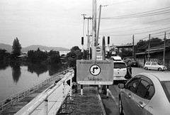000111 (lonely radio) Tags: film leicam6 leicasummicronm35mmf2type1 rangefinder people pond lampang thailand signs cars traffic river wangriver