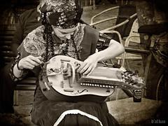 Afinando (Franco DAlbao) Tags: francodalbao dalbao fuji misica music musician vigo galicia zanfoa hurdygurdy tradicin tradition mujer woman instrumento instrument medieval monochrome