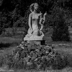 Black and white statue on rocks (Dave and Jodi Piddington) Tags: chernobyl ukraine holiday decay abandonedbuildings death history nucleardisaster accident travel dark tourism darktourism photography architecture nuclear disasters adventure kiev blackandwhite