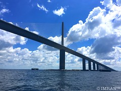 Miss Sunshine's Buoying A SkyWay (Bridge) To (Winter) Haven - IMRAN (ImranAnwar) Tags: stpetersburg imran landmark engineering architecture waves clouds bluesky water marine jetskiing yachting sailing boating gulfofmexico tampabay tampa bridge usa tourism iphoneography iphone6splus