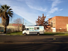 The Pearl (misterbigidea) Tags: street blue sky urban food building tree brick cooking kitchen yellow mobile truck fence wagon landscape waiting open view empty stripe palm business mexican taco meal handpainted lonely parked hungry lettering stockton taqueria tapatia laperla roachcoach lonlely onwheels inbetweenmeals