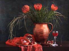 Pincushion Sultry Passions (panga_ua) Tags: flowers red stilllife orange art floral fruit composition canon spectacular artwork darkness artistic availablelight knife pomegranate ukraine poetic seeds creation fabric jug imagination natalie pincushion wineglass arrangement tabletop bodegon naturemorte panga artisticphotography rivne naturamorta pincushionprotea artphotography palegreen leucospermum proteaceae coppercolored sharpfocus pomegranatejuice inflorescences woodentabletop metallicplate  nataliepanga pastelsbackground pincushionsultrypassions prominentstyles
