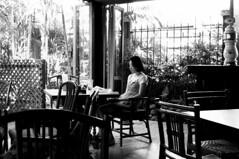 A Girl in a Cafe (kh1234567890) Tags: girl thailand japanese cafe slim pentax bangkok candid tables hp5 streetphoto ilford k7 19dec da21 smcpda21mmf32al truegrain 21mmlimited smcpentaxda21mmf32allimited