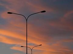 Al tramonto (RoBeRtO!!!) Tags: rdpic sunset orange blue sky clouds streetlamp tramonto cielo azzurro arancio nuvola lampione nikon