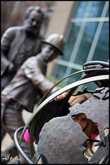 Peaking through the world (FirehawkNS) Tags: statue nc charlotte northcarolina att bellsouth phonecompany