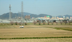 DSC08337 (prietke) Tags: trees signs mountains field japan train truck buildings asia rail powerlines shinkansen bullettrain tokaido tokaidoshinkansen honshuisland