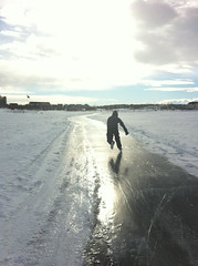 Ice Skating on Prairies (Mr. Happy Face - Peace :)) Tags: park winter light cloud sun lake snow canada motion cold reflection ice nature weather race speed landscape fun pond glare shadows exercise action pov ryan skating sunny son canadian icerink alberta skate workout prairies iceskate winterwonderland sunsetsunrise actionshot wintry waterscapes speedskate outdoorrink jimmyb cans2s mrhappyface frozenlandscapes