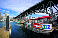 Aquabus Granville Island Station (TOTORORO.RORO) Tags: travel light canada tourism water colors ferry skyline vancouver buildings lens living boat rainbow dock bc angle zoom britishcolumbia taxi sony wide wideangle tourist highrise falsecreek service granvilleisland alpha popular visitor f4 hdr granvillebridge attractions aquabus oss nex greatervancouver mirrorless 1018mm nex6 aquabusferries sel1018