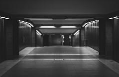 heimweg (HerrBohn) Tags: city urban blackandwhite bw berlin monochrome dark underground subway lights cityscape noiretblanc metro pentax walk empty ubahnhof corridor u ubahn sw walimex citywalk greyscale cityview bigb berlincity onmyway 85mmf14 schwarzweis untergrundbahn pentaxian justpentax pentaxonly pentaxk5 herrbohn walimexpro85mm14
