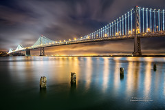 Bay Glow - San Francisco Bay Bridge 75th Anniversary (Darvin Atkeson) Tags: sanfrancisco lighting city bridge sky storm reflection fog night clouds project lights oakland bay skies glow suspension foggy illumination stormy baybridge embarcadero 75 stormynight 75th anniversay citybythebay darvin atkeson darv liquidmoonlightcom lynneal baylights