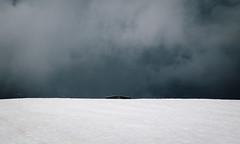 Black Clouds (Julien Laplanche) Tags: mountain snow alps rain clouds frenchalps