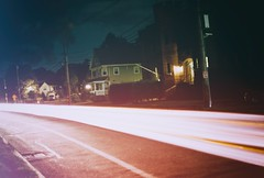 car lights (katabbey) Tags: night nighttime outdoors evening lighttrail cartrail neighborhood road highway longexposure film
