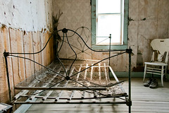 Ready for Bed (BradPerkins) Tags: abandonedtown decay ghosttown ghost abandoned eerie wires garnet shoes empty chair bedrame montana frame abandonedbuilding bed building urbanlandscape abandonedhouse urbanexploration