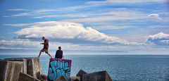 The Precious Steps We Take (Peter Kurdulija) Tags: ahuriri hawkesbay newzealand nzl new zealand napier hawkes bay perfume point recreation reserve east pier people couple concrete block ocean horizon sky cloud graffiti man woman symbolic decision sun day peter kurdulija pano