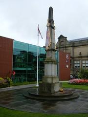 Fusilier Museum, Bury, Lancashire (rossendale2016) Tags: red colourful flowers sheet glass tinted poppies poppy weather dismal raining rain lancashire bury museum fusilier regimental flag remembrance cenotaph