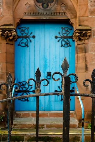 blue entrance − wrought-iron work