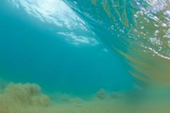 the underside view (bluewavechris) Tags: ocean sea beach water canon hawaii movement sand surf underwater wave maui fisheye swell pound 815 shorebreak