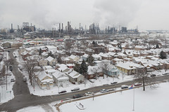 Whiting, Indiana (metroblossom) Tags: above houses winter snow building buildings industrial cloudy indiana photograph bp juxtaposition residential e1 whiting almostthere ktq kartemquinfilms northwesternindiana whitingrefinery img8552c