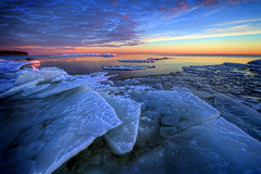 The ice is high (Matthias Lehnecke | www.ml-foto.se) Tags: blue winter red sea sky orange lake snow seascape cold ice water yellow clouds canon landscape rocks sweden wideangle crisp saturation 7d blocks vnern dalsland canon1022mm lakescape icescape iceblocks iceformations melleud hjortensudde