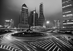 Shanghai at night [Explore #1 - 02/18/13] (DMac 5D Mark II) Tags: china city longexposure travel bw streets tourism architecture night buildings lights google shanghai chinese photojournalism scene intersection roads pudong baidu journalism googleimages daum douglasmacdonald