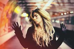 9 lives (Daisy Oak) Tags: light portrait woman black paris color colors face animal female night cat hair subway lights movement model hands nikon focus alone hand metro bokeh body feminine fingers ears clothes whiskers hide blond blonde half rails catwoman onblack daisyoak