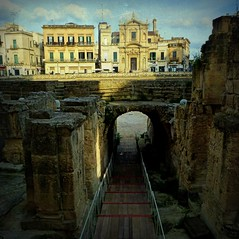 into the lions' den, Roman Amphitheatre - Lecce, Puglia (jjamv - no activity 19-27) Tags: sky italy building texture church architecture temple italia roman postcard capital columns amphitheatre iglesia cielo corinthian classical column piazza duomo bar