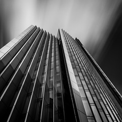 Sawtooth (vulture labs) Tags: city uk longexposure england sky urban blackandwhite bw building london art geometric lines skyline architecture clouds skyscraper square photography photo long exposure industrial geometry fineart curves filter crop format daytime sleek density sawtooth neutral willisbuilding londonskyline daytimelongexposure nd110 d700 fineartphotograph vulturelabs