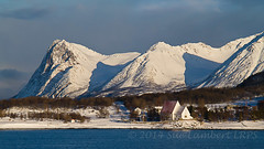 Snowy Peaks and little church (Nanooki) Tags: morning blue winter white snow mountains cold church norway landscape coast space arctic peaks hurtigruten harstad trondenes httpsenwikipediaorgwikitrondeneschurch norwegiancoastalboat