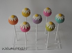 Birthday Treat - Sunflowers Cake pops (Welcome Treats) Tags: show birthday uk pink blue wedding orange green yellow cake vintage dessert shower happy groom bride engagement sticks couple married purple fairs handmade events norfolk style wed retro special celebration sunflower bridesmaid norwich chic bridal pops congratulations marry favors engage bespoke shabby stalham favours favour bridalfairs weddingfairs bridalshows cakepops cakepop bridalevents weddingfavoursnorfolk welcometreats weddingfavourcakepops welcometreatsnorwichnorfolk cakepopsnorwich cakepopsnorfolk cakepopsstalham welcometreatshandmade weddingcakesnorfolk weddingcupcakesnorfolk weddingcakesnorwich weddingfavoursnorwich weddingcupcakesnorwich weddingcakesstalham weddingfavoursstalham weddingcupcakesstalham weddingcakeshicklingnorfolk weddingcakesstalhamnorfolk weddingcakesnorwichnorfolk weddingcakesgreatyarmouth celebrationcakesgreatyarmouth cakepopsgreatyarmouth biscuitsgreatyarmouth