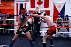 Krudar Muay Thai - The Uprising (thericyip.com) Tags: toronto sports sport demo eos athletic fight movement kick guard gloves elbow thai knockout block shorts punch boxing fighters fighting athlete knee ufc muay uprising shin muaythai mma uppercut 1dx canon35mmf14l krudarmuaythai canoneos1dx canon1dx