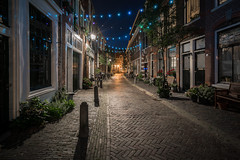 Lighting the way (McQuaide Photography) Tags: haarlem noordholland northholland netherlands nederland holland dutch europe sony a7rii ilce7rm2 alpha mirrorless 1635mm sonyzeiss zeiss variotessar fullframe mcquaidephotography lightroom adobe photoshop tripod manfrotto light licht night nacht nightphotography stad city urban lowlight architecture outdoor outside illuminated street straat kokstraat backstreet window wideangle wideanglelens groothoek building longexposure