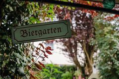 Biergarten (MSC_Photography) Tags: garten garden bokeh nikon d5100 d200 mf nikkor 28mm f35 ai wide open manual bier beer prunus cerasifera swirly