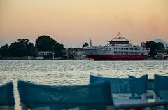 Ferry boat - Eretria, Chalkis (kutruvis nick) Tags: greece greek hellas chalkis eretria port ferryboat ship sea water sky sunset chairs trees buildings nik kutruvis nikon d5100
