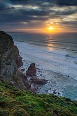 Clifftop (intrazome) Tags: ocean blue light sunset sea england sun reflection green nature water coast nikon cornwall surf waves cliffs coastline d5100