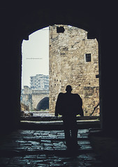 The Gate (Zagros.os) Tags: lebanon man silhouette architecture photography gate citadel historic tripoli