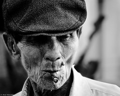 The Boat Builder. (Neil. Moralee) Tags: portrait bw white man black monochrome face hat work fix boat smoke an crew repair ment sail smoker build builder bodge hio wrinckle neilmoraleenikon neilmoraleevietnamnikond7000 bodgeing